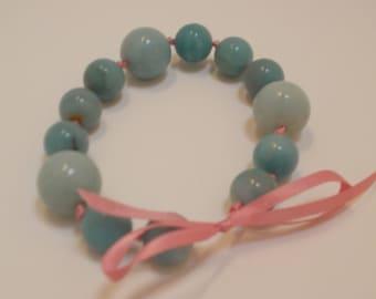 "Bracelet: 8"" Bracelet with Natural Stone Blue Beads Strung on Pink Ribbon"