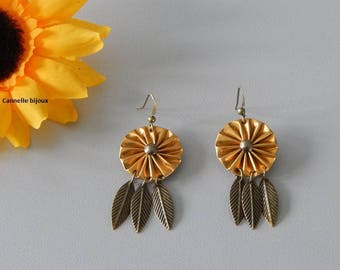 Feathers and gold caps earrings bronze