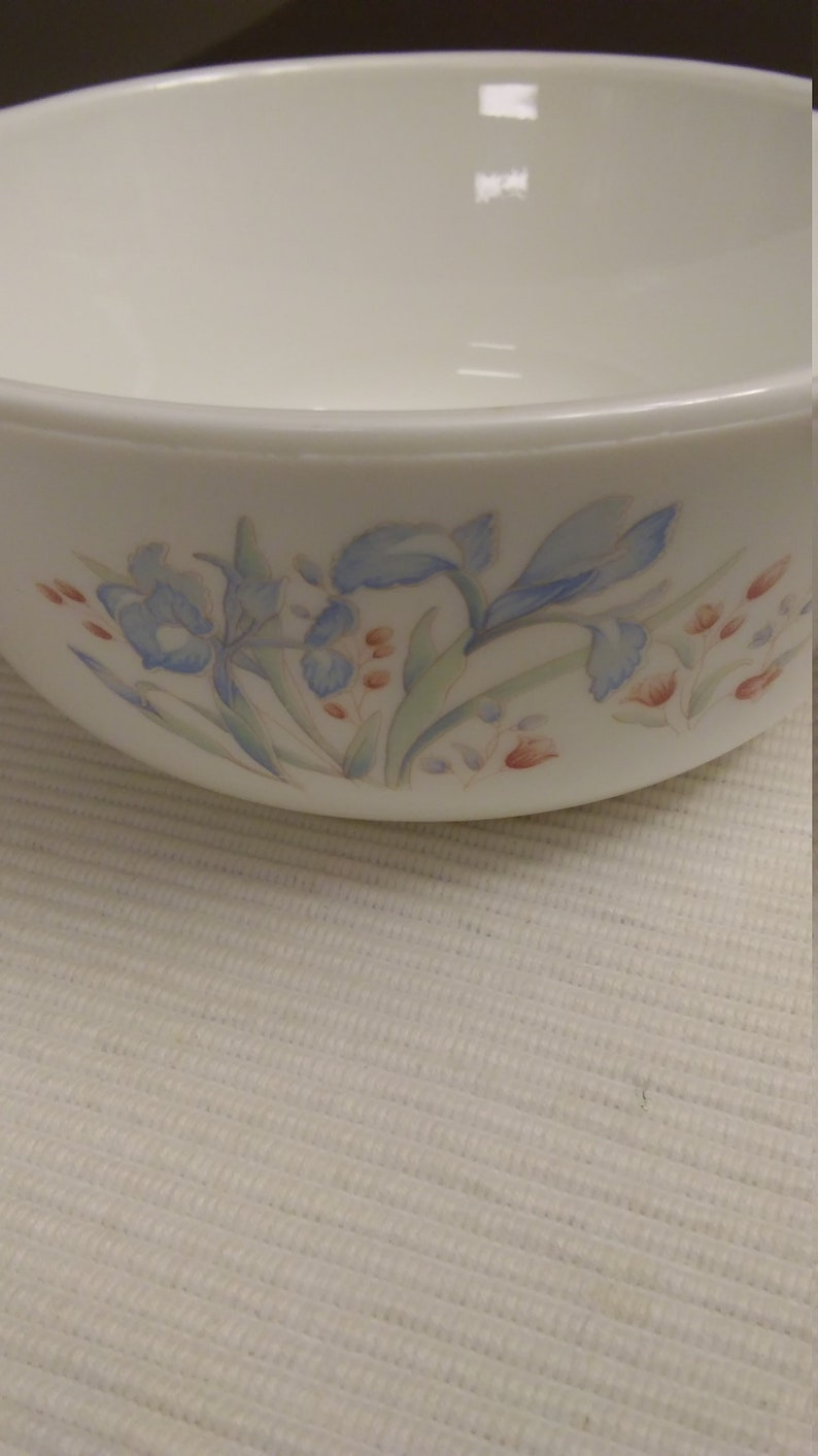Pyrex small baking dish with blue and maroon flowers made in England.