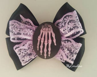 Boned purple hand brooch and Hairbow