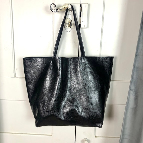 Black metallic leather tote bag with inside zipper pocket