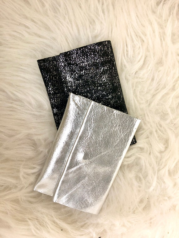 Silver or black leather coin holder