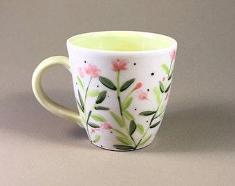 handmade pottery mug, porcelain tea cup, hand painted wildflower design, pink, green, garden party, gift, chai cup, hand made coffee mug