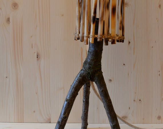 Tripod natural style wooden table lamp.