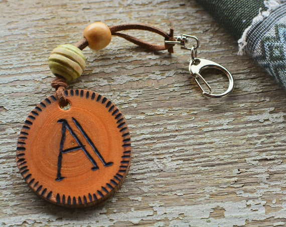Pyrographed personalized initials wooden keychain.