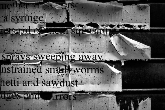 Sweeping away photographic prints.