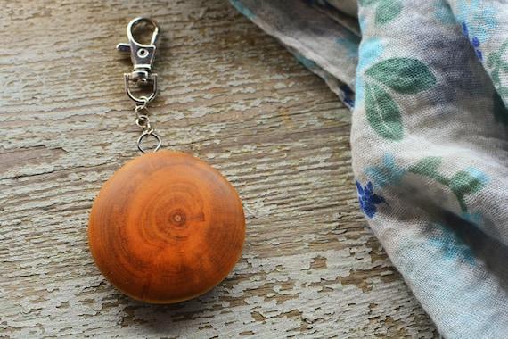 Wooden wild cherry charm keychain.
