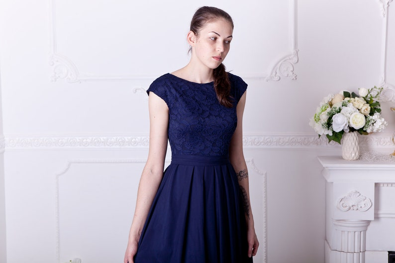 2f193f72112 Long navy blue bridesmaid dress with cap sleeves. Modest lace