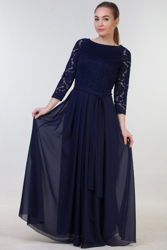 Long navy blue bridesmaid dress with sleeves.