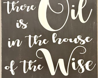 """There is oil in the house of the wise, Rustic Wood Sign! 10x10"""""""