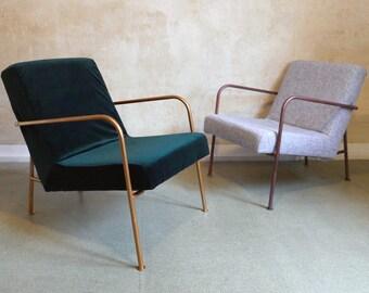 Green velvet cozy armchair with bronze metal frame