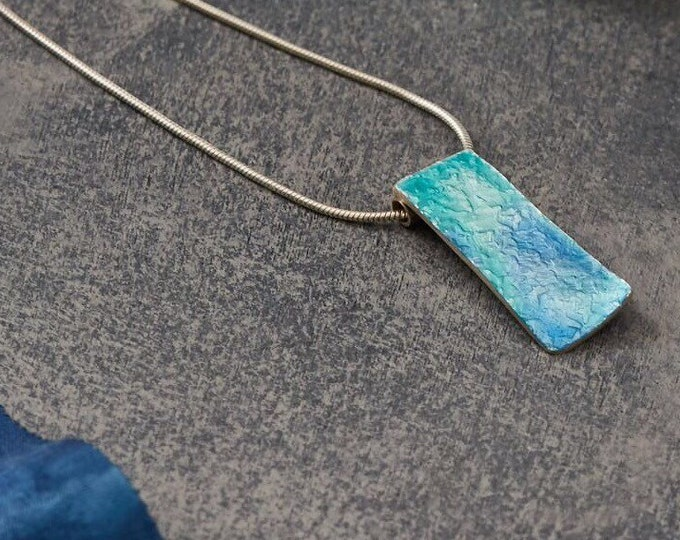 Aqua wave enamel on silver pendant with chain