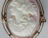 Carved pink cameo with golden French border circa 1920 brooch