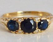 Vintage 18 carat gold ring with natural sapphires and diamonds