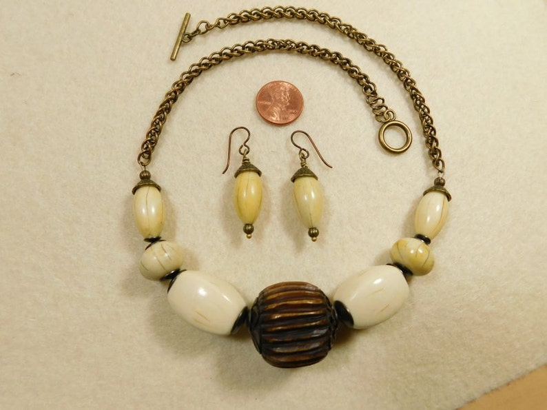 Vintage wood center bead and faux ivory