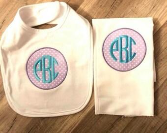 Appliqué burp cloth and bib gift set.