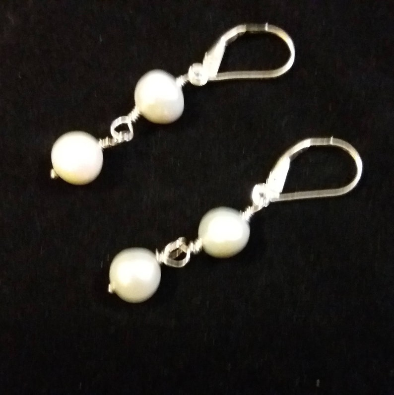 Cultured Pearl 22 inch necklace set with pearl pendant  and earrings to match in sterling silver.