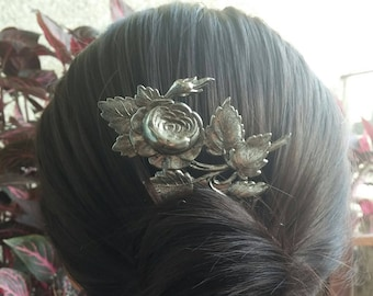 Comb with a brass silver rose branch
