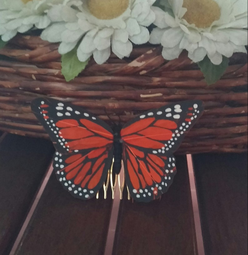 Orange feather comb with butterfly