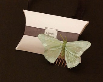 Comb with light green feather butterfly