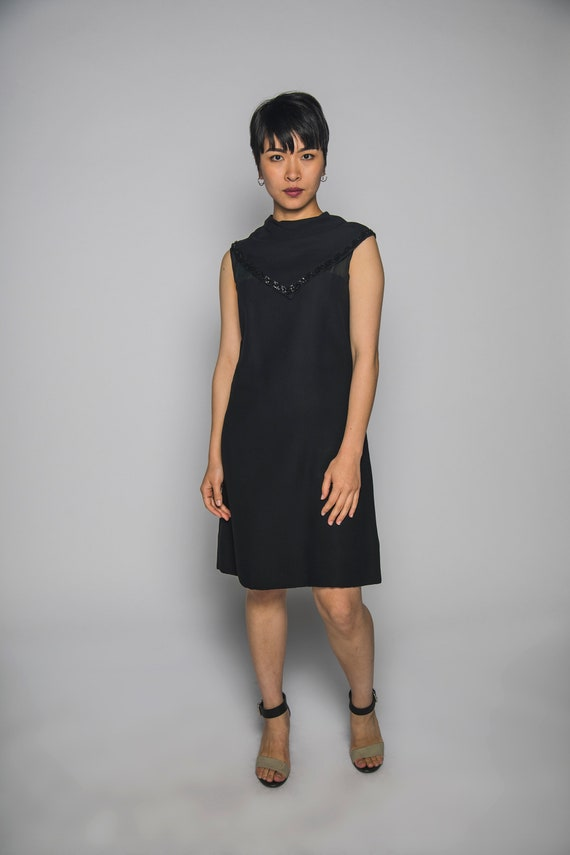 Large Classy 1960s Black Dress with Criss Cross details