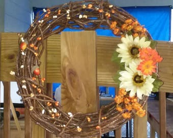 Wreath with flowers and berries and acorns