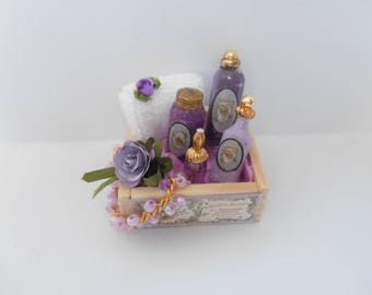 Wooden trays with perfume bottles