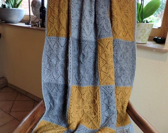 """Plaid """"Ida"""" is lovingly knitted from pure virgin wool by Grandma Christa. It's a cozy blanket for cuddling up on cool evenings"""