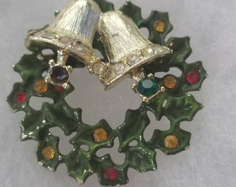 Very vintage ! Huge 2 inch bell wreath.    Christmas brooch. Rhinestones of all colors. Signed