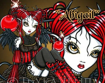 """Myka Jelina PSP tube of """"Abigail"""" a red gothic fairy with a cherry bomb."""