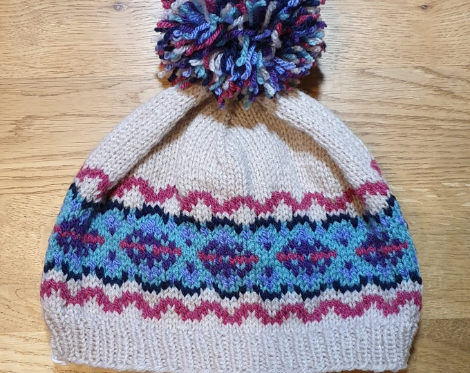 Beige / multi hand knitted Fair Isle pom pom hat