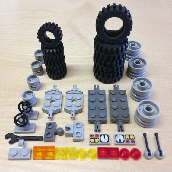 Lego 4 Black 2x2 plate axle tire vehicle car truck NEW