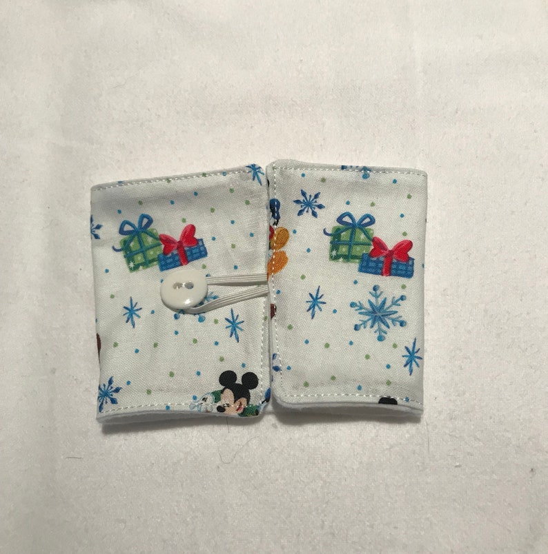 Disney characters holiday coffee cozy image 0