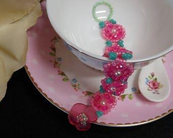 Pretty pink beaded bracelet with flowers