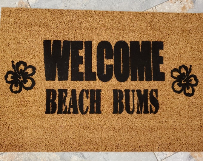 Welcome Beach Bums Doormat. Makes it feel like Summer is Here. Enjoy the sandy beach and Hawaiian flowers. The perfect gift for beach lovers