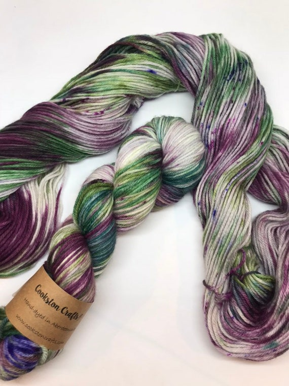 Thistly Brae 100g 100% Superwash Merino DK, hand dyed yarn in Scotland, green purple lilac variegated.