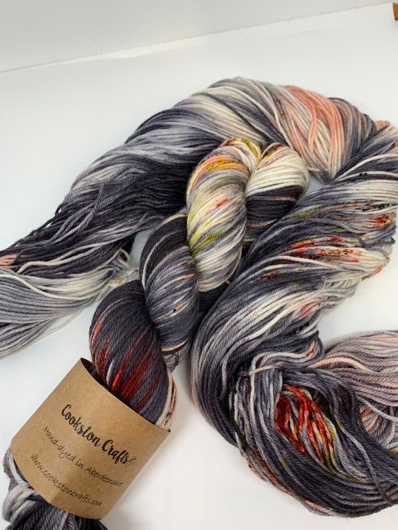 Tammie Norrie / Puffin  - 100g 75/25% Superwash Merino/ Nylon , DK double knit yarn, hand dyed in Scotland, grey black orange yellow speckle