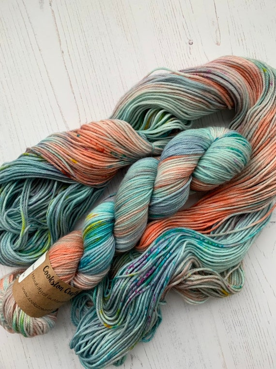 Puggled - 100g 75/25% Superwash Merino/ Nylon , DK double knit yarn, hand dyed in Scotland turquoise, coral, blue, green, pink speckles