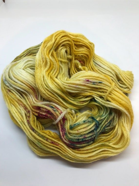 50g 100% Superwash Merino DK double knit yarn, hand dyed in Scotland, mustard yellow with pink and green speckles