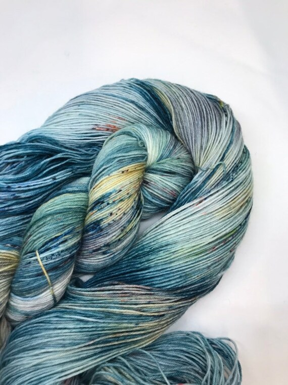 Outlander - 100g Superwash Merino / Nylon Sock Yarn 4 ply, fingering, hand dyed in Scotland, teal, green speckles, grey