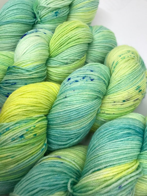 Flotta - 100g superwash merino / nylon Sock Yarn 4 ply, fingering, hand dyed, variegated lime green, yellow, blue speckles