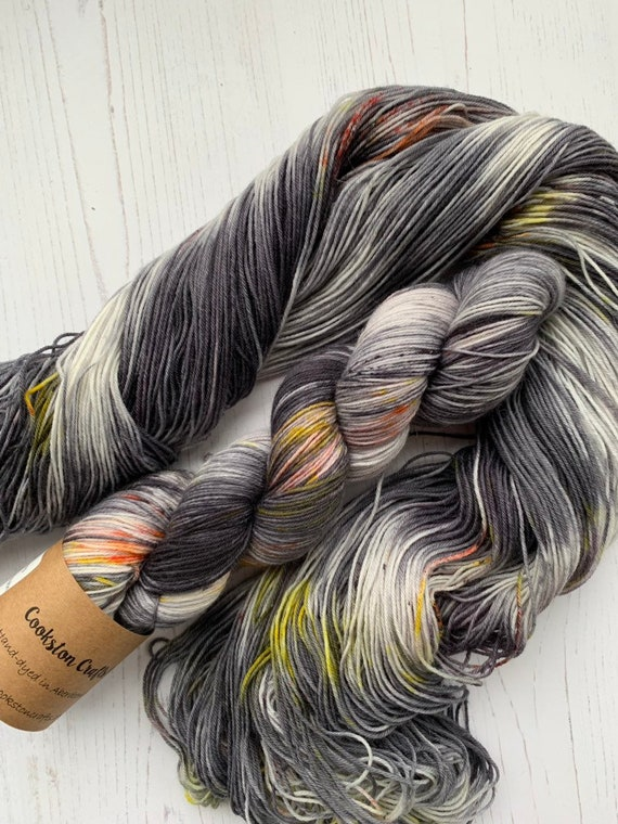 Tammie Norrie - 100g Superwash Merino / Nylon Sock Yarn 4 ply, fingering, hand dyed in Scotland, black, grey, orange speckles puffin