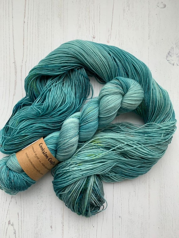 Outlander - 100g Superwash Merino / Nylon Sock Yarn 4 ply, fingering, hand dyed in Scotland, teal, green speckles, grey