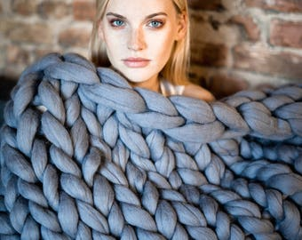 Chunky knit blanket from premium merino wool. Eco and organic certified. Soft, warm and anti-allergic arm knitted throw in different colors.