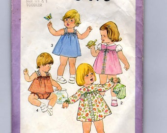 Simplicity 8495 size 1/2   1 a 1977 Toddlers Dress, Jumper,Sundress,tops and panties with bedding ribbon trim sewing pattern in cut,unfolded