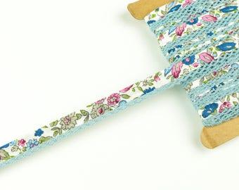 1 m diagonal ribbon with crochet braid green-pink-blue on white