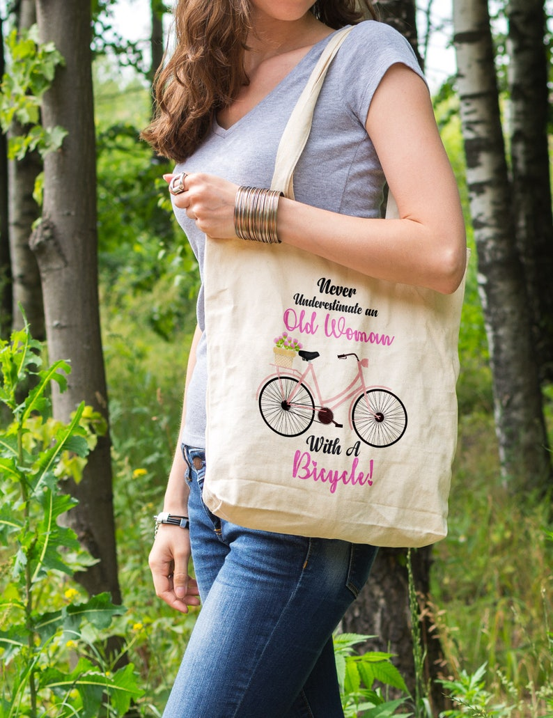 fd0fd7ee77d0 Cotton Tote Bag, Never Underestimate An Old Woman On A Bicycle, bicycle  bag, woman bag, bicycle accessory, old lady, gifts,bike tote bag