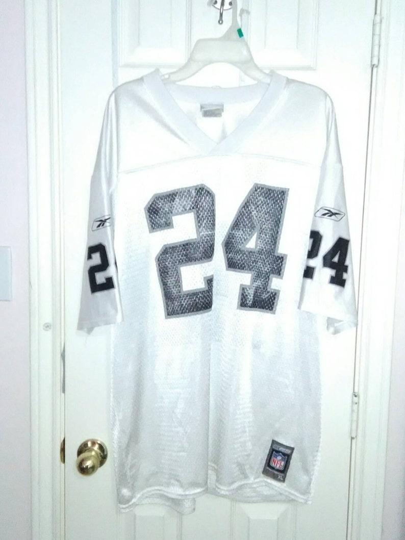 buy popular 19064 884d5 Oakland Raiders vintage Reebok Jersey charles woodson sz XL