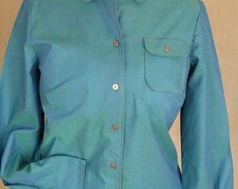 Unworn tonic original blouse from St Michaels. Lovely subtle tonic in a blue/green.