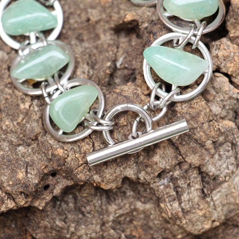 Gear bracelet with Green Gemstones